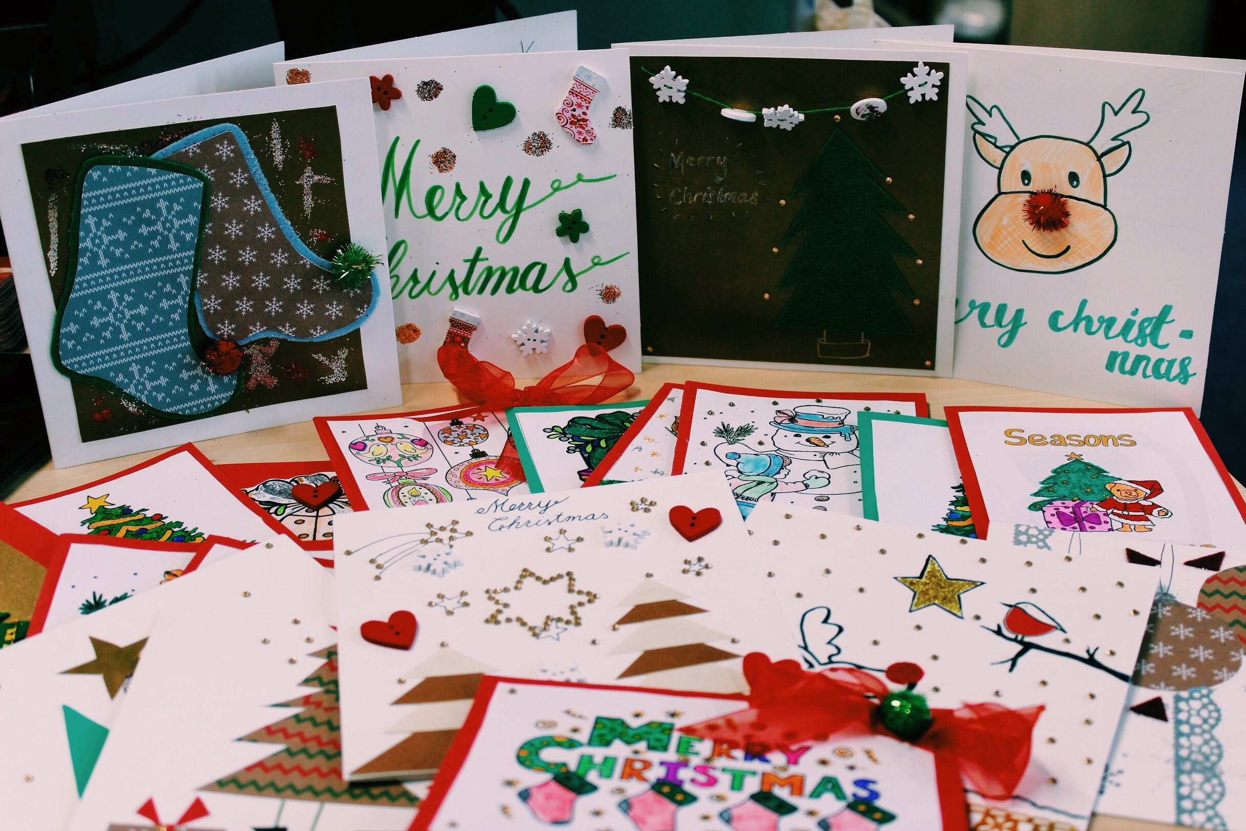 students create christmas cards for contact the elderly